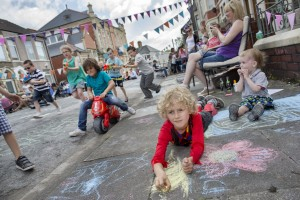 01/06/2014  Pics (C) Huw John, Cardiff. Tel: 07860 256991. MANDATORY BYLINE - HUW JOHN  The Big Lunch, Beda Road, Canton Findlay Howells-Aitken chalking.  From: mail@huwjohn.com 3 Towy Road, Llanishen, Cardiff CF14 0NS www.huwjohn.com